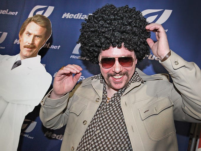 A mustache wearing cut out figure of movie star, Will Ferrell (left) seems to joining in with the fun along with George Milberger, during the Movember Indy Month End Gala Party at the SpBro Speak Easy club. The local Movember chapter raised $8,500 for cancer research. Movember is a cause to raise vital funds and awareness for menÕs health, specifically prostate cancer and other cancers that affect men.