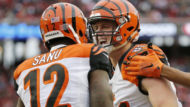 Cincinnati Bengals tight end Tyler Kroft (81) and wide receiver Mohamed Sanu (12) celebrate Kroft's touchdown in the second quarter of the NFL Week 15 game between the San Francisco 49ers and the Cincinnati Bengals at Levi's Stadium in Santa Clara, Calif., on Sunday, Dec. 20, 2015. At the half, the Bengals led 21-0.
