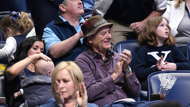 Actor Bill Murray, whose son Luke is the assistant coach at Xavier, waits for the team's game against Texas Southern in the 2018 NCAA Division I Men's Basketball Championship at Bridgestone Arena Friday, March 16, 2018 in Nashville, Tenn.