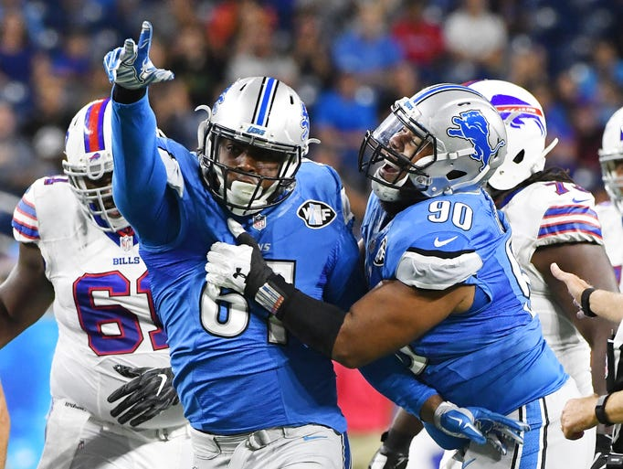 Detroit Lions' Kerry Hyder and Gabe Wright celebrate