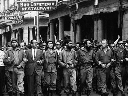"""FILE - In this March 5, 1960 file photo, Cuban leaders walk arm-in-arm at the head of the funeral procession for the victims of the La Coubre explosion, blamed by the Cuban government on a U.S. bomb attack on the Cuban ship La Coubre in the harbor of Havana, Cuba. From left to right are Cuba's leader Fidel Castro, the first president of post-Batista Cuba, Osvaldo Dorticos, Ernesto """"Che"""" Guevara, Defense Minister Augusto Martinez-Sanchez, ecology minister Antonio Nunez-Jimenez, American William Morgan from Toledo, Ohio, and Spaniard Eloy Guttierez Menoyo. Castro has died at age 90. President Raul Castro said on state television that his older brother died late Friday, Nov. 25, 2016."""