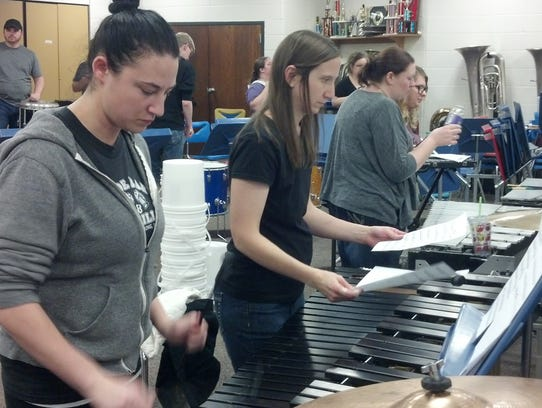 Rocori alumni drum line members rehearse for their
