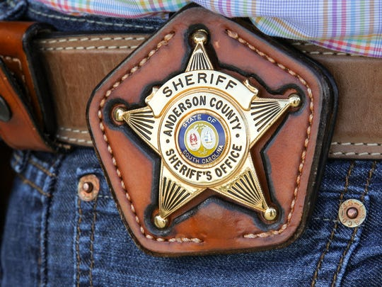 Anderson County Sheriff Chad McBride wears his badge on his belt during a press conference on Wednesday outside the Sheriff's Office in Anderson.