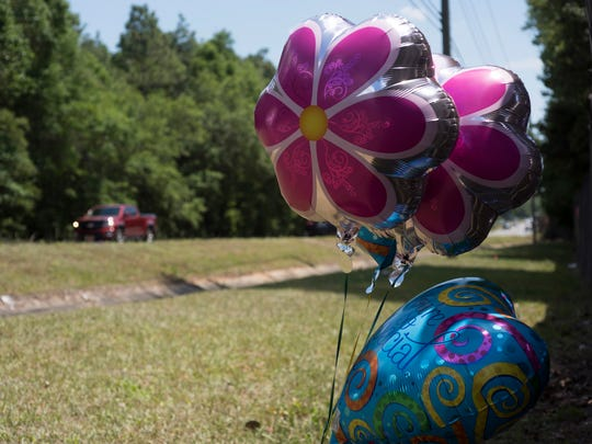 A makeshift memorial can be seen Monday, May 7, 2018, on Woodbine Road in Pace, where a suspected drunken driver crashed into a vehicle and killed two sisters.
