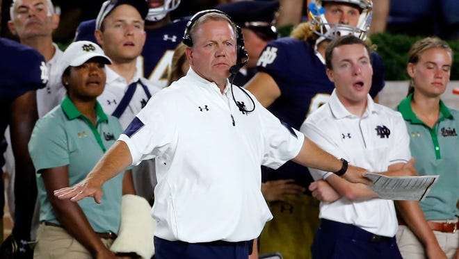 """""""I think we freed them up to play a lot faster and that's helped us,"""" Notre Dame coach Brian Kelly says of the Irish defense."""