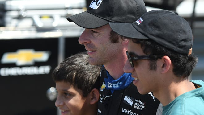 IndyCar driver Simon Pagenaud poses with fans at the Mid-Ohio Sports Car Course on July 21.