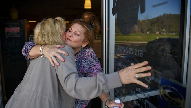 Chonda Pierce is greeted with a hug from Melanie Vuocolo at her favorite restaurant Vuocolo's Italian in Ashland City, Tenn., Tuesday, April 4, 2017.