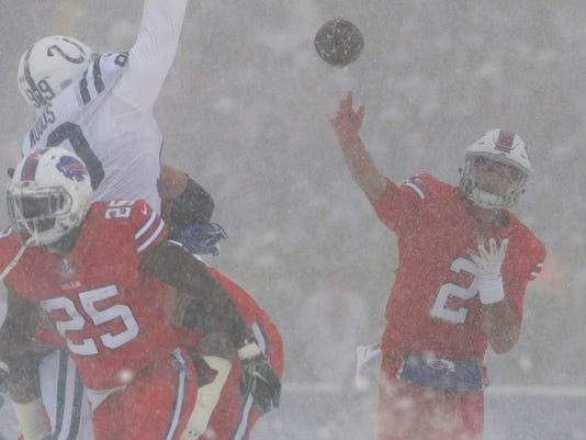 Buffalo Bills quarterback Nathan Peterman passes during the first half of an NFL football game against the Indianapolis Colts, Sunday, Dec. 10, 2017, in Orchard Park, N.Y. (AP Photo/Adrian Kraus)