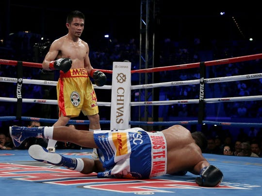 Roman Gonzalez is knocked down for the first time against Srisaket Sor Rungvisai at StubHub Center in Carson, Calif.