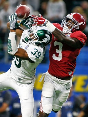 Michigan State cornerback Jermaine Edmondson, left, fights for the ball against Alabama in Arlington, Texas, on Dec. 31, 2015.