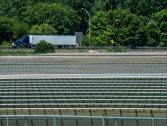 Rows of solar panels sit near Interstate 70 at an Indiana