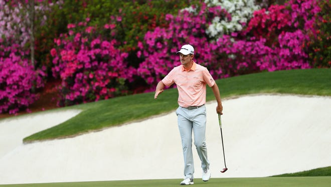 Apr 5, 2018; Augusta, GA, USA; Justin Rose reacts after missing a putt on the 13th green during the first round of the Masters golf tournament at Augusta National Golf Club. Mandatory Credit: Rob Schumacher-USA TODAY Sports