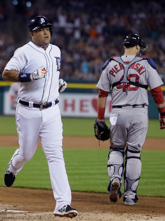 Detroit Tigers' Miguel Cabrera scores on a single by teammate Victor Martinez during the fourth inning of a baseball game against the Boston Red Sox in Detroit, Sunday, June 8, 2014. (AP Photo/Carlos Osorio)