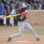 Holy Cross junior Nic Gephart swings at a pitch.