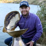 Branden Grace poses with the trophy after the final round of the Qatar Masters in Doha.