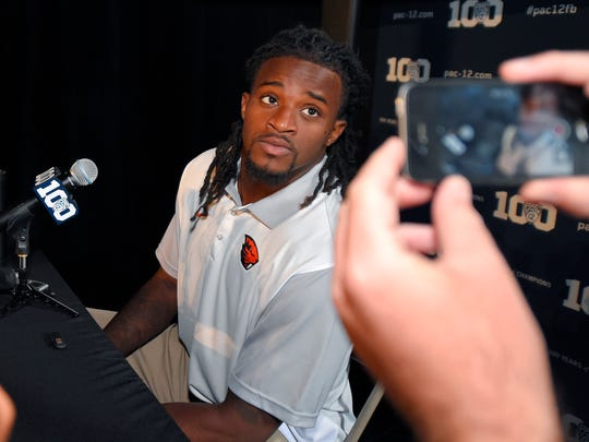 Oregon State cornerback Larry Scott speaks to reporters during NCAA college Pac-12 Football Media Days, Thursday, July 30, 2015, in Burbank, Calif.