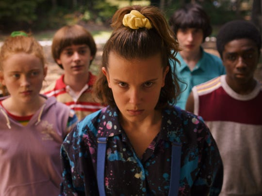 Sadie Sink, Noah Schnapp, Millie Bobby Brown, Finn Wolfhard, and Caleb McLaughlin in a scene from season three of Netflix's  Stranger Things .