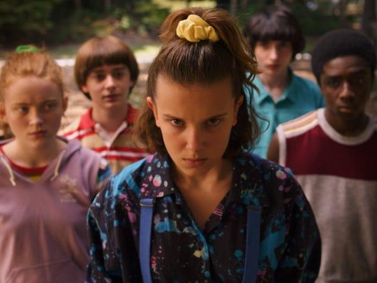 "Sadie Sink, Noah Schnapp, Millie Bobby Brown, Finn Wolfhard, and Caleb McLaughlin in a scene from Netflix's ""Stranger Things"" Season 3."