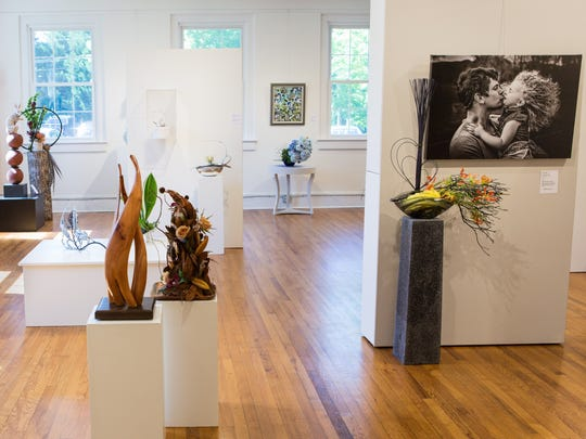 Art in Bloom at The Gallery at Flat Rock runs May 25-28. The exhibit pairs visual art works with  flower arrangements.