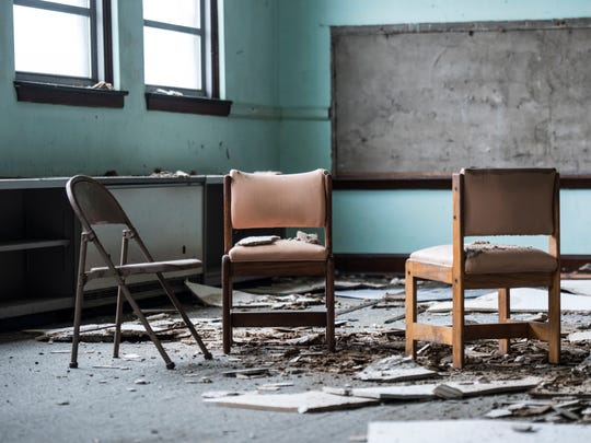 The crumbling interior of the abandoned, old Milton Public School is seen Tuesday, April 10, 2018.