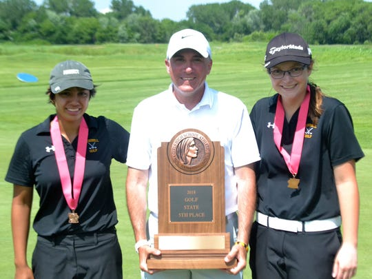 Grinnell Tiger coach Mark Kivett, center, is with Bella Amador-Lacson, left, who placed eighth and Alisha Ford, who tied for 10th.