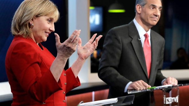 New Jersey Lt. Gov. Kim Guadagno, beside Assemblyman Jack Ciattarelli, speaks during a Republican gubernatorial primary debate on May 18 in Newark.