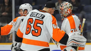 Flyers goalie Steve Mason, right, will make his sixth straight start Thursday. Anthony Stolarz likely won't make his debut this week.