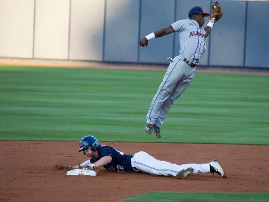 Ole Miss junior J.B. Woodman steals second base and the throw is high for Melvin Gray, Friday night at Swayze Field.