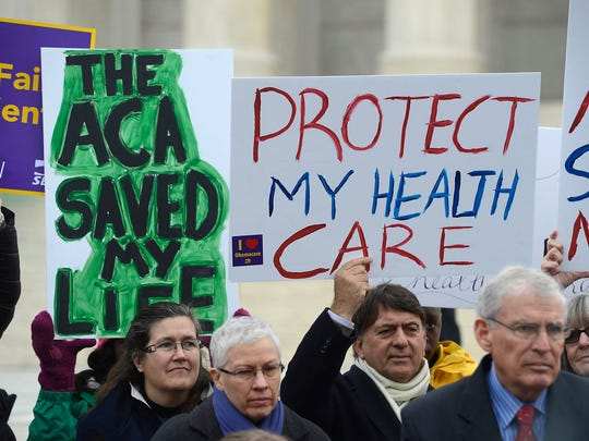 Supporters of the Affordable Care Act demonstrate outside the Supreme Court during oral arguments in 2015.