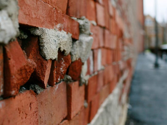 The Zarfos Furniture building is shown next to a parking