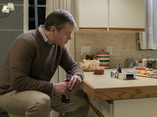 """Matt Damon (left) discusses the advantages of getting small with Jason Sudeikis (the little guy) in """"Downsizing."""""""