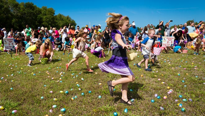 Children race to gather more than 25,000 Easter eggs during the 21st annual Royal Scoop Easter Egg Hunt at New Life Church on Saturday, April 4, 2015, in Bonita Springs.  The annual Easter event featured a 25,000-egg Easter egg hunt, relay races and an ice cream eating contest. (David Albers/Staff)