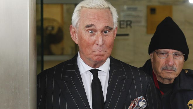 In this Feb. 1, 2019 file photo, former campaign adviser for President Donald Trump, Roger Stone, leaves federal court in Washington.