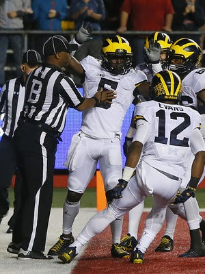 Michigan Wolverines linebacker Jabrill Peppers (5) reacts after scoring a touchdown against Rutgers Scarlet Knights during first half at High Point Solution Stadium,Piscataway,NJ. Saturday, October 8, 2016. Noah K. Murray-Correspondent/Asbury Park Press Michigan vs. Rutgers football