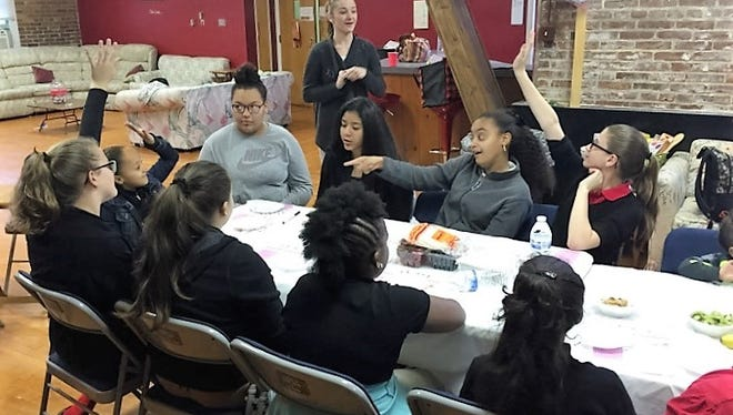 """Members of the SMART Girls from the Boys & Girls Club of Vineland recently joined with members of MOOD (Molding Our Outstanding Daughters) for a Recipe Remix. Jenna Gavigan, a registered dietitian from ShopRite, educated the girls on what is included in a """"healthy plate."""" She quizzed the girls on their knowledge of healthy fruits and vegetables. Participants also followed a recipe to make fruit burritos. During the event, the girls from each group had an opportunity to get to know one another."""