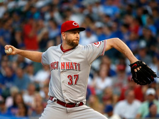 Cincinnati Reds starting pitcher Scott Feldman winds up during the first inning of the team's baseball game against the Chicago Cubs on Wednesday, May 17, 2017, in Chicago. (AP Photo/Charles Rex Arbogast)