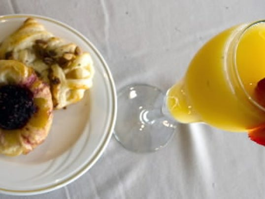 All brunch meals come with a complimentary mimosa and basket of fresh pastries.