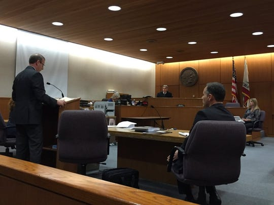 Aaron Starr, right, listens as attorney Brian Hildreth addresses Ventura County Superior Court Judge Rocky Baio in 2016. Starr's legal battles with the city of Oxnard has a storied past.