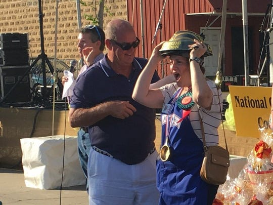 Bob Kellermann, CEO of Lodge Cast Iron Manufacturing Company, center, congratulates Ronna Farley of Rockville, Maryland, on her grand-prize win at the National Cornbread Festival in this 2016 file photo. Emcee David Karnes of WRCB-TV is in the background.
