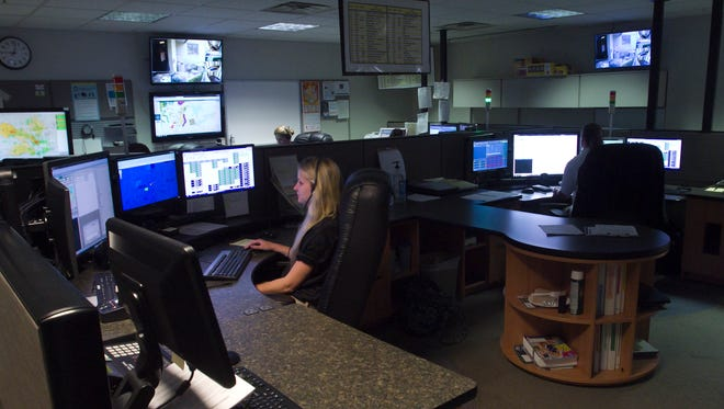 Dispatcher Nikki Wagner, center, and fellow staff members of Livingston County 911 Central Dispatch in Howell handle emergency calls Thursday, Aug. 3, 2017. Plans are in the works to build a new facility just west of the existing building.