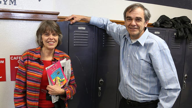 Mary Beth Tinker, and her brother, John Tinker, stand next to locker 319 on Tuesday, Nov. 19, 2013, at Harding Elementary School in Des Moines, the school Mary Beth attended when she was suspended for wearing a black armband to protest the Vietnam War. The locker was dedicated for the Tinkers.