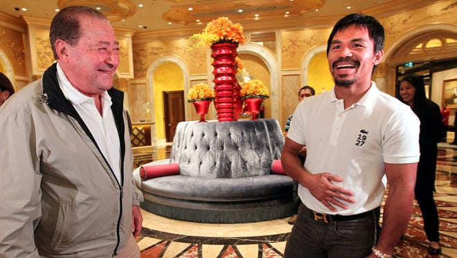 Hall of Fame promoter Bob Arum, left, greets Manny Pacquiao as he arrives at The Venetian Macao Resort for his Nov. 23rd fight against Brandon Rios. Pacquiao won the fight.