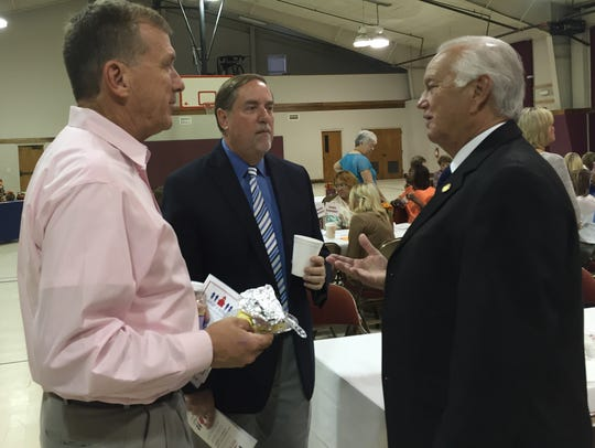 State Sen. Mike Walsworth talks with Superintendent