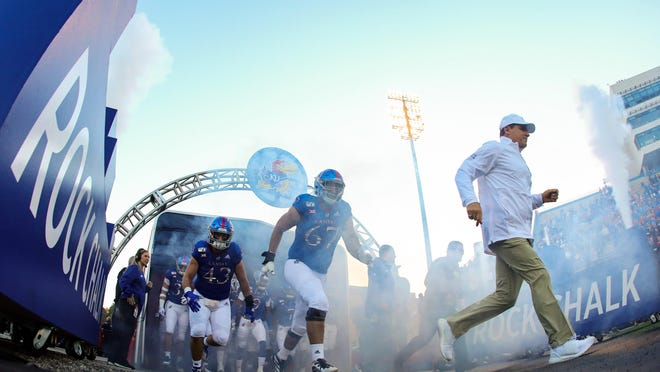 Kansas football coach Les Miles, right, and the Jayhawks resumed their voluntary workouts program Wednesday following a two-plus-week hiatus.
