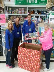 Menard's team members stand with Barb Thill, a coordinator of Fond du Lac Salvation Army's Christmas gift program. Menard's hosts a toy and gift collection box, and invite help filling it.  Other collection locations: Ascension Lutheran, FDL public library, Wink Chiropractic, Culver's on Pioneer and on East Johnson, Festival Foods, Salem United Methodist Church, St. Paul's Cathedral, Papa Murphy's, Sunny 97-7, Dental Associates, The Salvation Army Thrift Store, North Fond du Lac's Spillman Library, Silica, Fox Valley Savings Bank, Society Insurance, Shopko, FDL Convention Center, Burger King, Midwest Dental, both locations of Hometown Bank, Fleet Farm, FDL Children's Museum, and Culver's on West Johnson. Gifts and toys collected through Dec. 7.