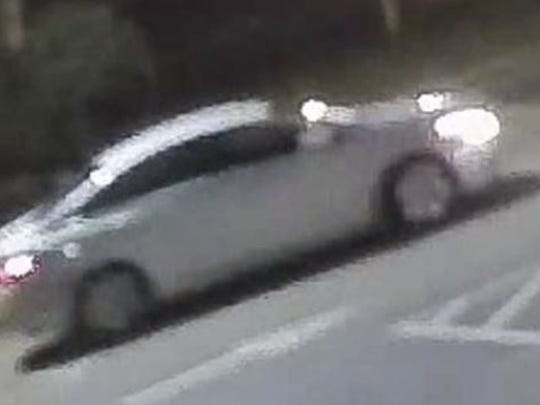 The suspect was seen leaving in what appeared to be a silver compact car, possibly a Nissan Sentra.