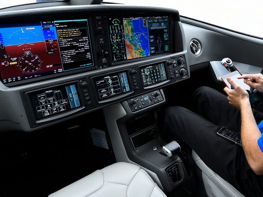 Pilot Matt Bergwall goes through his pre-flight check. The Vision features  side yoke controls, the Cirrus Perspective Touch™ by Garmin® avionics and Synthetic Vision Technology.