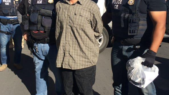ICE Enforcement and Removal Operations officers escort