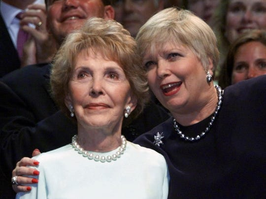 Former first lady Nancy Reagan (left) receives a hug from Maureen Reagan, eldest daughter of former President Ronald Reagan.