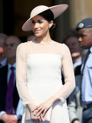 In her first post-royal wedding engagement, Duchess Meghan of Sussex attends a garden party at Buckingham Palace to celebrate father-in-law Prince Charles' birthday and charitable endeavors, on May 22, 2018.